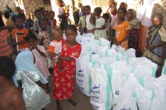 Food-distribution-poor-child-holding-baby